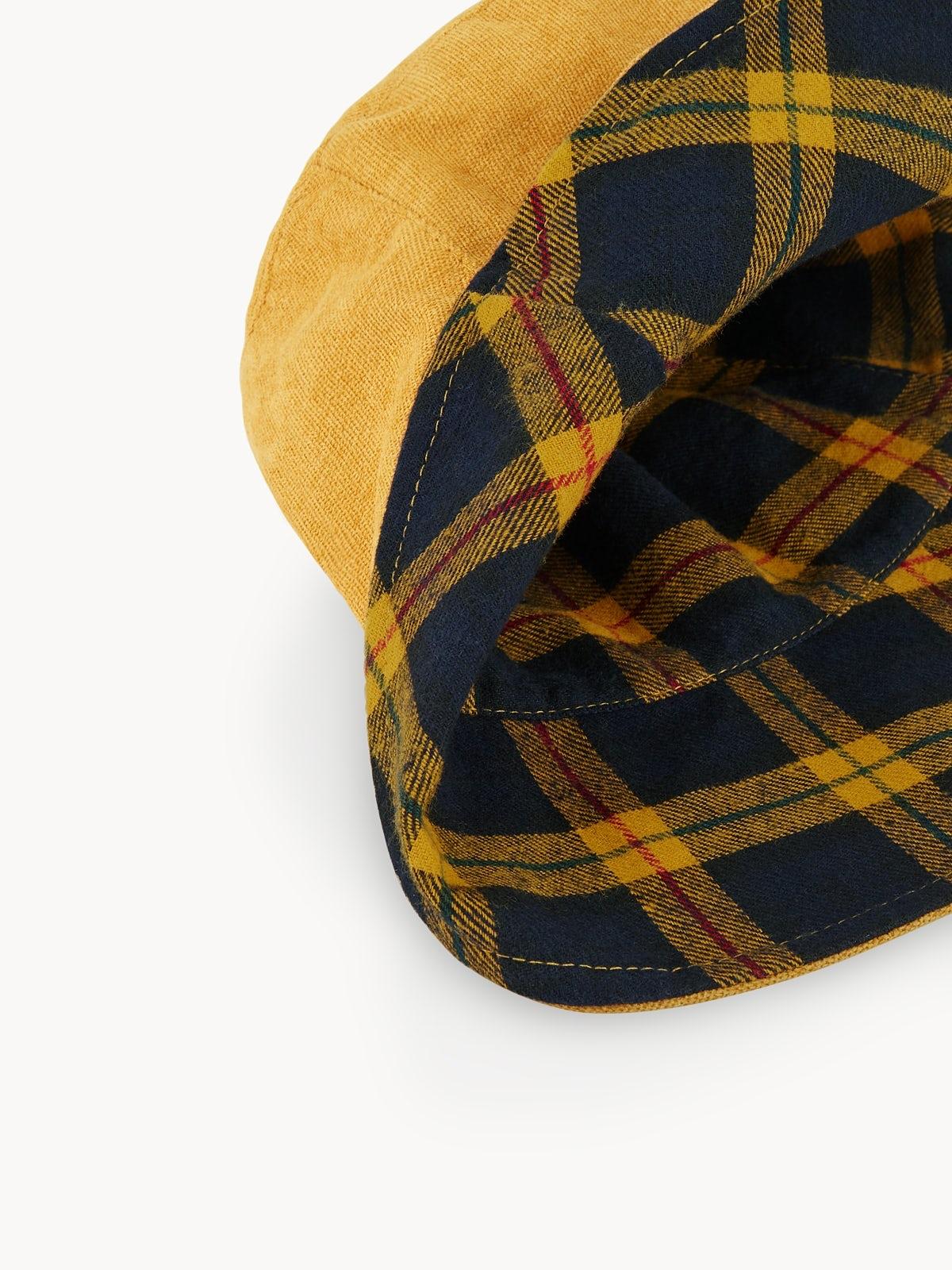 cf53dd3461724 Price  390 ฿  Name  Reversible Tartan Bucket Hat - Yellow  icon